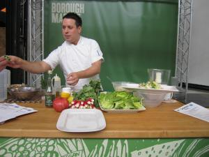 Chef preparing hand-held Caesar salad at Borough Market